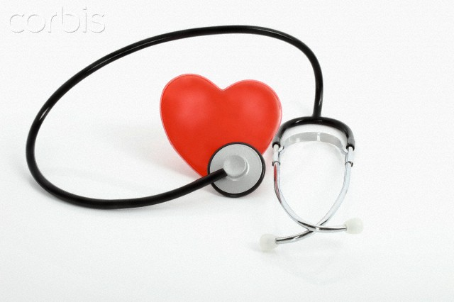 Heart with stethoscope on white background