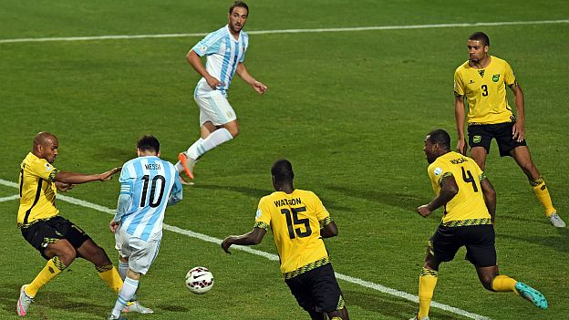 Argentina's forward Lionel Messi (2nd L) tries to dribble past (L to R) Jamaica's midfielders Rodolph Austin and Je-Vaughn Watson and Jamaica's defender Wesley Morgan and Michael Hector , during their 2015 Copa America football championship match against Jamaica, in Vina del Mar, on June 20, 2015. AFP PHOTO / PABLO PORCIUNCULA