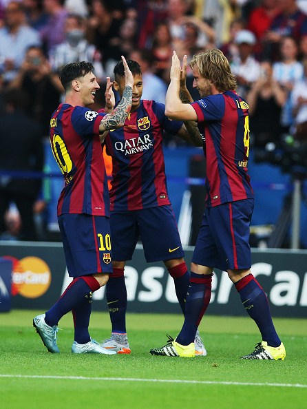 BERLIN, GERMANY - JUNE 06: Lionel Messi of Barcelona congratulates Ivan Rakitic of Barcelona on his goal during the UEFA Champions League Final between Barcelona and Juventus at Olympiastadion on June 6, 2015 in Berlin, Germany. (Photo by Ian MacNicol/Getty Images)