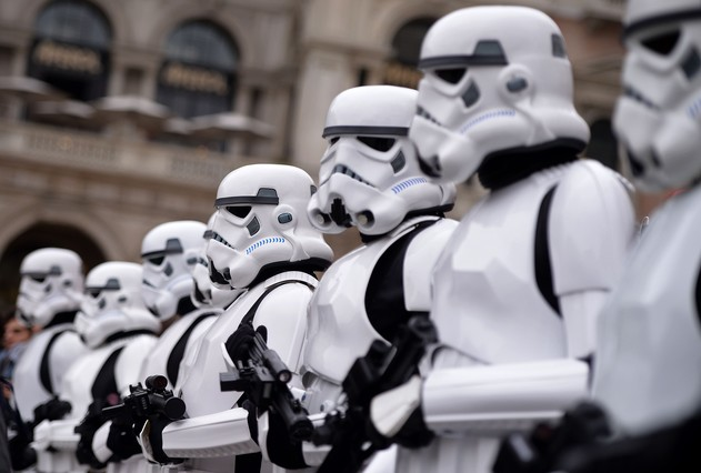 "Cosplayers dressed as ""Star Wars"" stormtroopers stand in front of Milan's Duomo on May 3, 2015 as part of Star Wars Day. AFP PHOTO / FILIPPO MONTEFORTE"